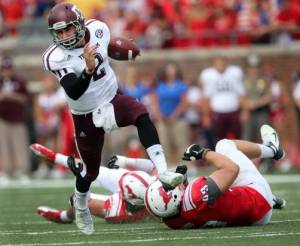 Johnny Manziel beat opponents with his arm and his legs all season long. (Image courtesy of http://www.dallasnews.com/sports/college-sports/texas-aggies/20120917-writer-texas-am-s-johnny-manziel-looks-like-a-potential-heisman-candidate-down-the-road.ece.)