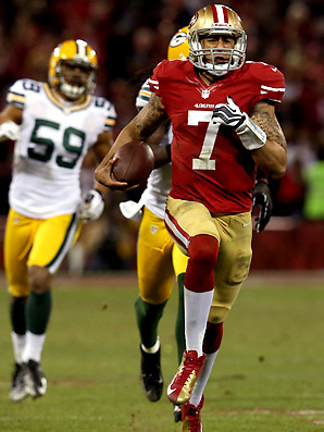 San Francisco 49'ers quarterback Colin Kaepernick set an NFL record for rushing yards by a quarterback in a single game with 181 yards against Green Bay. (Image courtesy of http://sportsillustrated.cnn.com/nfl/news/20130113/nfl-playoffs-49ers-packers/)