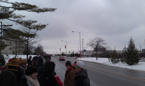 """Indiana University students with General Admission tickets line up across the street from Assembly Hall in the """"pre-line"""" before the GA line officially starts at 3 pm."""