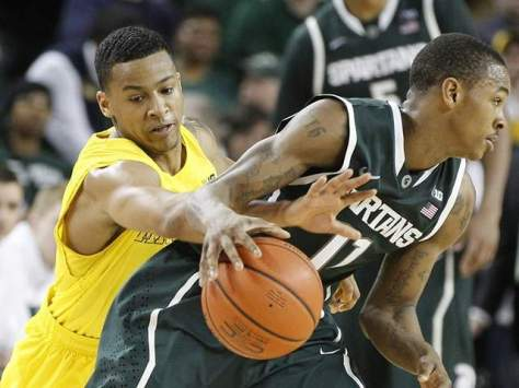 Michigan sophomore point guard Trey Burke sealed a victory for the Wolverines when he stole the ball from Keith Appling on March 3. (Image courtesy of www.freep.com)