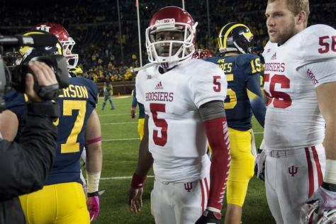 Sophomore quarterback Tre Roberson looks to the scoreboard after IU's game against the University of Michigan on Saturday at Michigan Stadium. (BEN MIKESELL | IDS)
