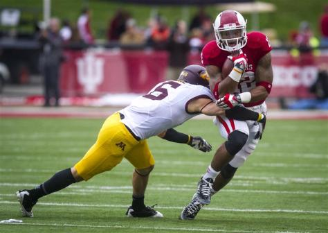 Senior Stephen Houston runs past a Minnesota defender during IU's loss to Minnesota on Saturday evening at Memorial Stadium. (CLAYTON MOORE | IDS)